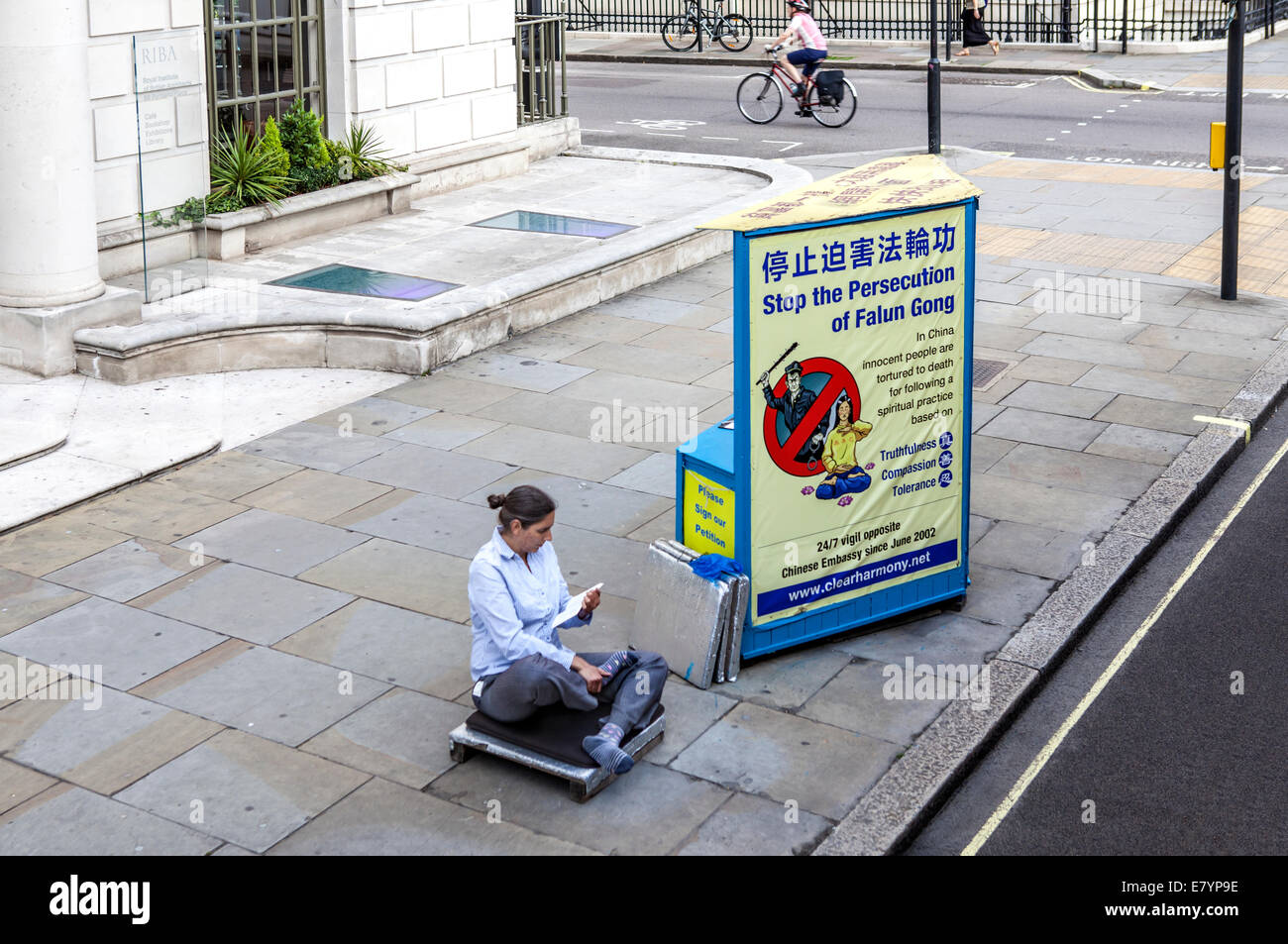LONDON, ENGLAND - May 2012: Activists take turns on Portland Place, in front of the Chinese Embassy in London to - Stock Image