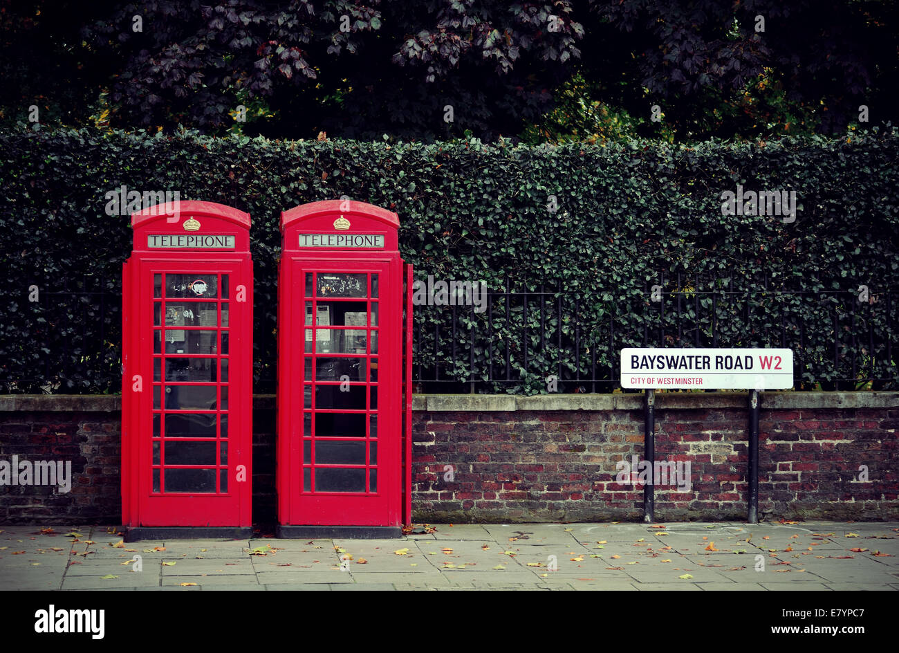 Telephone box in London street. - Stock Image