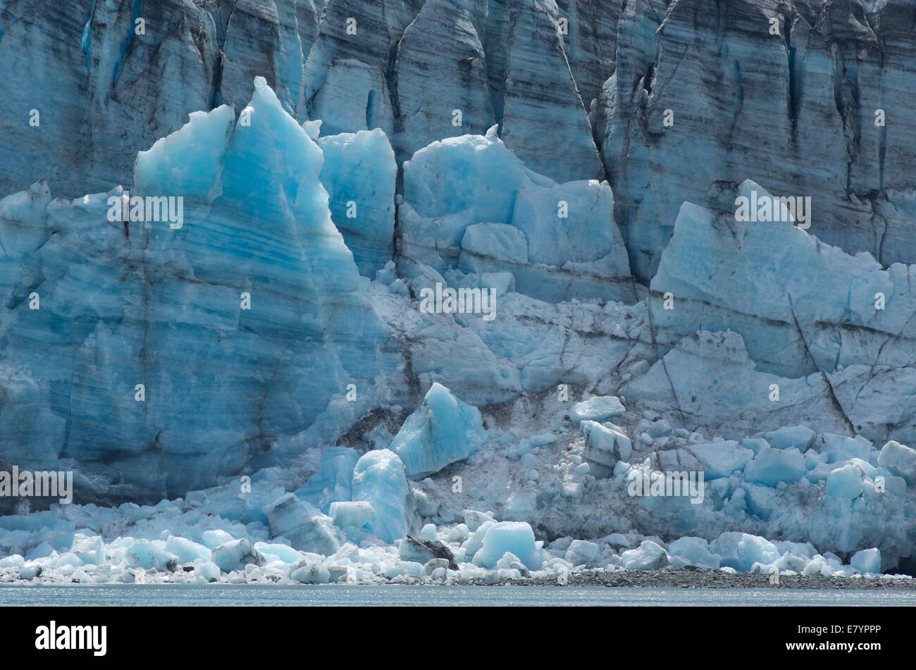 A horizontal slice of the deep blue Johns Hopkins Glacier in Glacier Bay, Alaska. - Stock Image