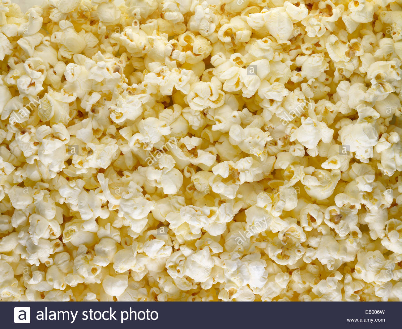 Popped corn or natural white popcorn snack shot as background. - Stock Image