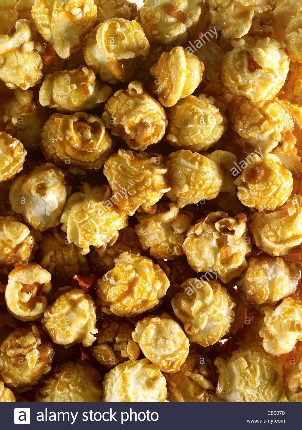 Raw dried un-popped Corn or natural popcorn kernels as background. - Stock Image