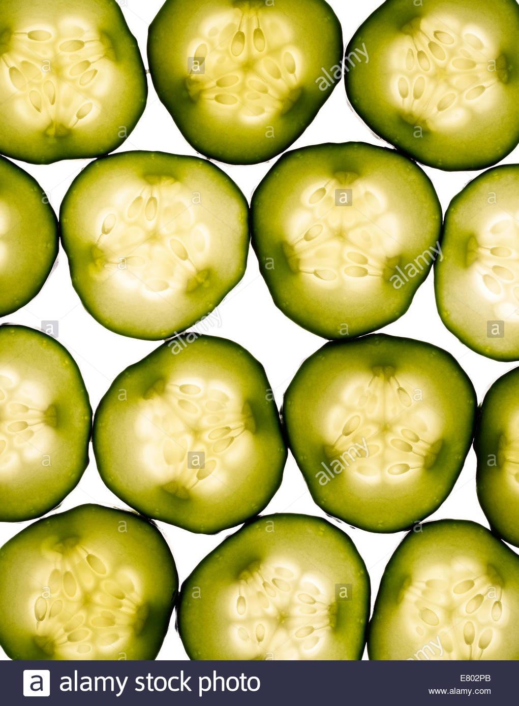 Fresh slices of cucumber on white background - Stock Image