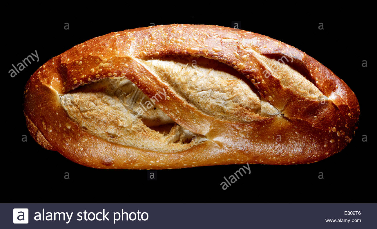 Old Fashion baked bread loaf on black background - Stock Image