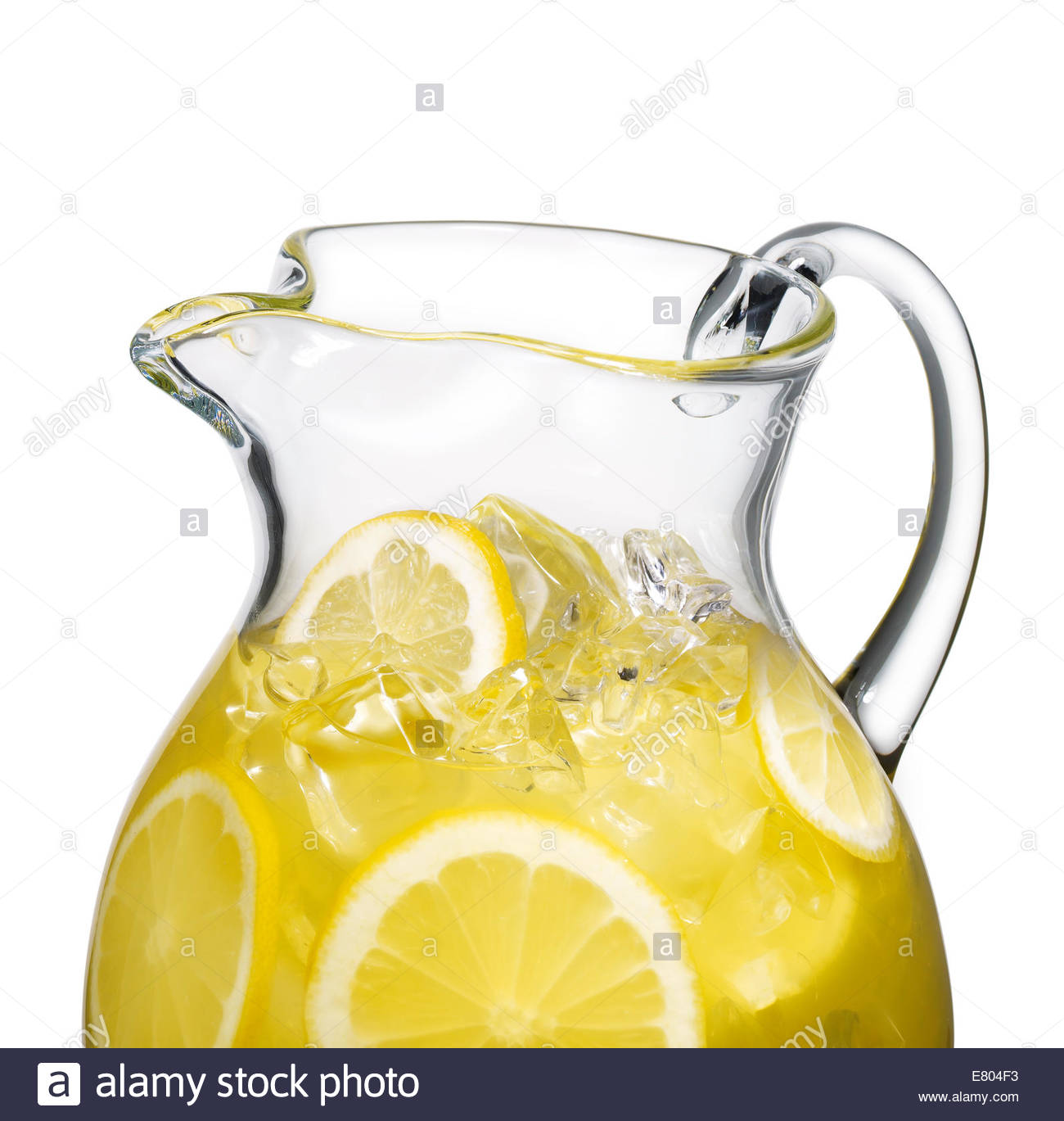 Lemonade pitcher with lemon slices and ice cubes isolated on white - Stock Image
