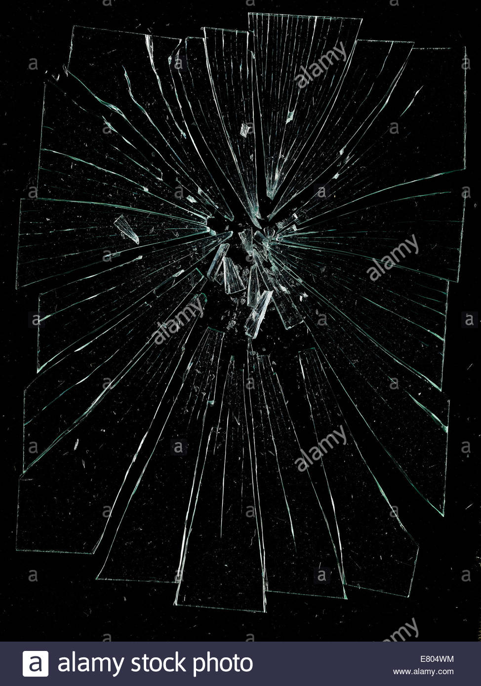 shattered into pieces, cracked & broken glass against black background - Stock Image