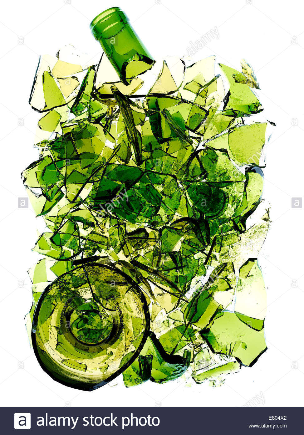 shattered & broken green color bottle against white background - Stock Image