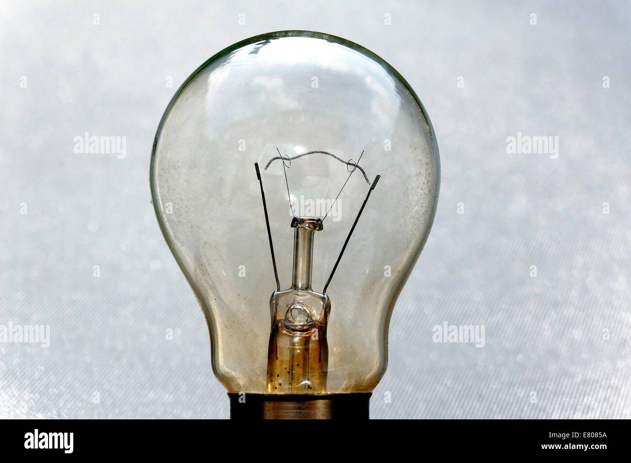 Close Up Shot Of A Light Bulb With A Broken Filament Stock Photo