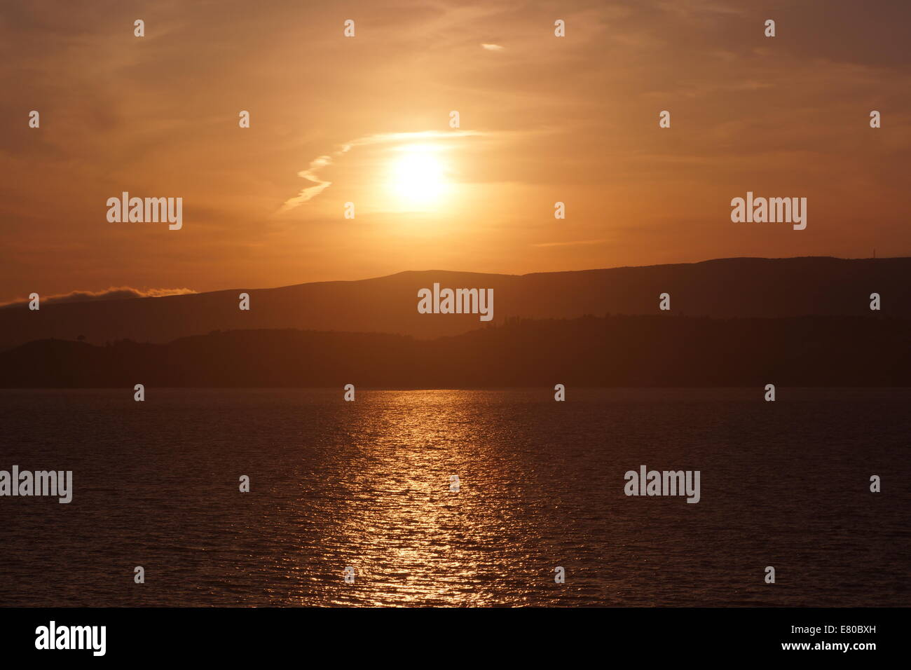 Setting sun, reflection on sea, Kefalonia - Stock Image
