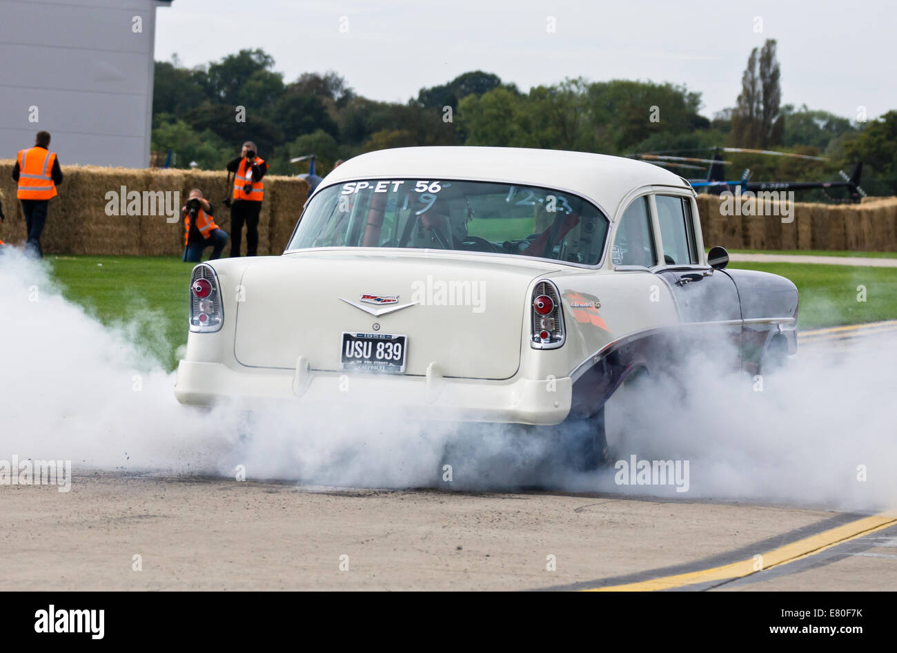Sywell Aerodrome, Northamptonshire, UK. The Footman James Classic 'Piston & Props'. Drag cars burn rubber - Stock Image
