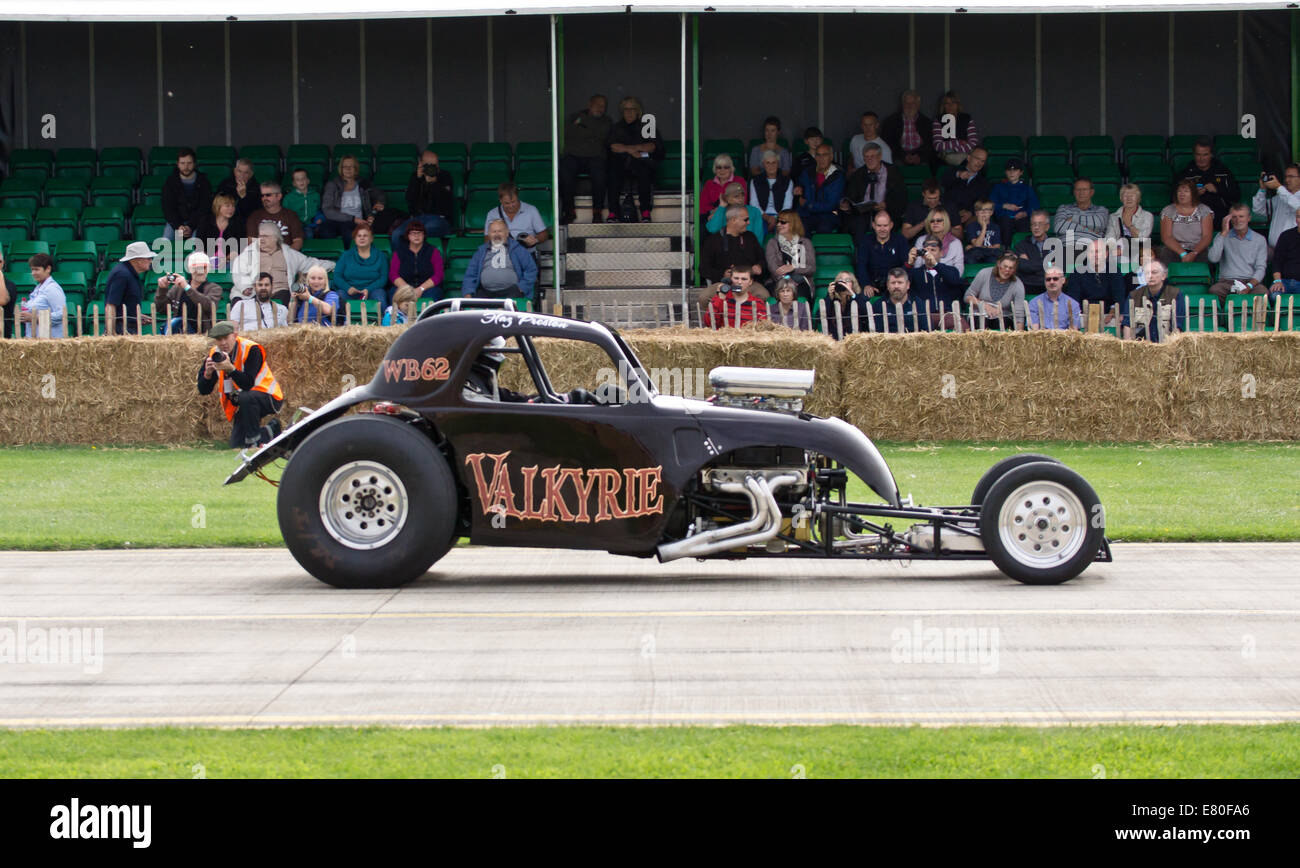 Sywell Aerodrome, Northamptonshire, UK.The Footman James Classic 'Piston & Props'. Drag cars burn rubber - Stock Image