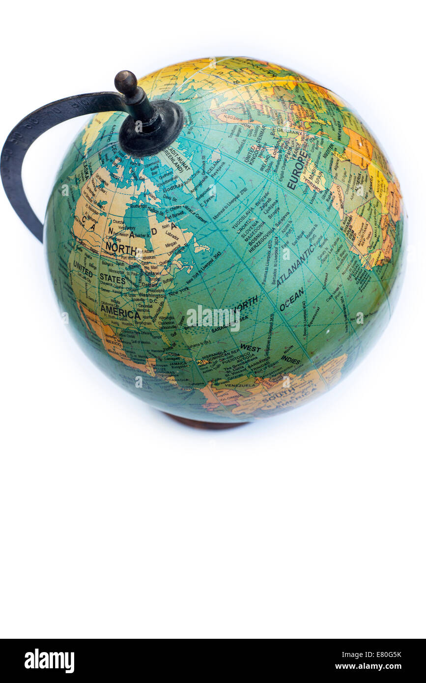 Still life of an antique globe on a white background - Stock Image