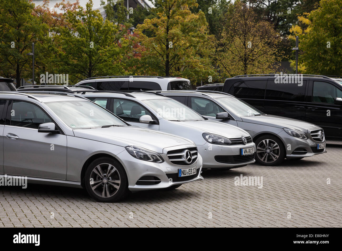 Mercedes and VW cars parked outside of the 65th IAA Commercial Vehicles 2014 in Hannover - Stock Image