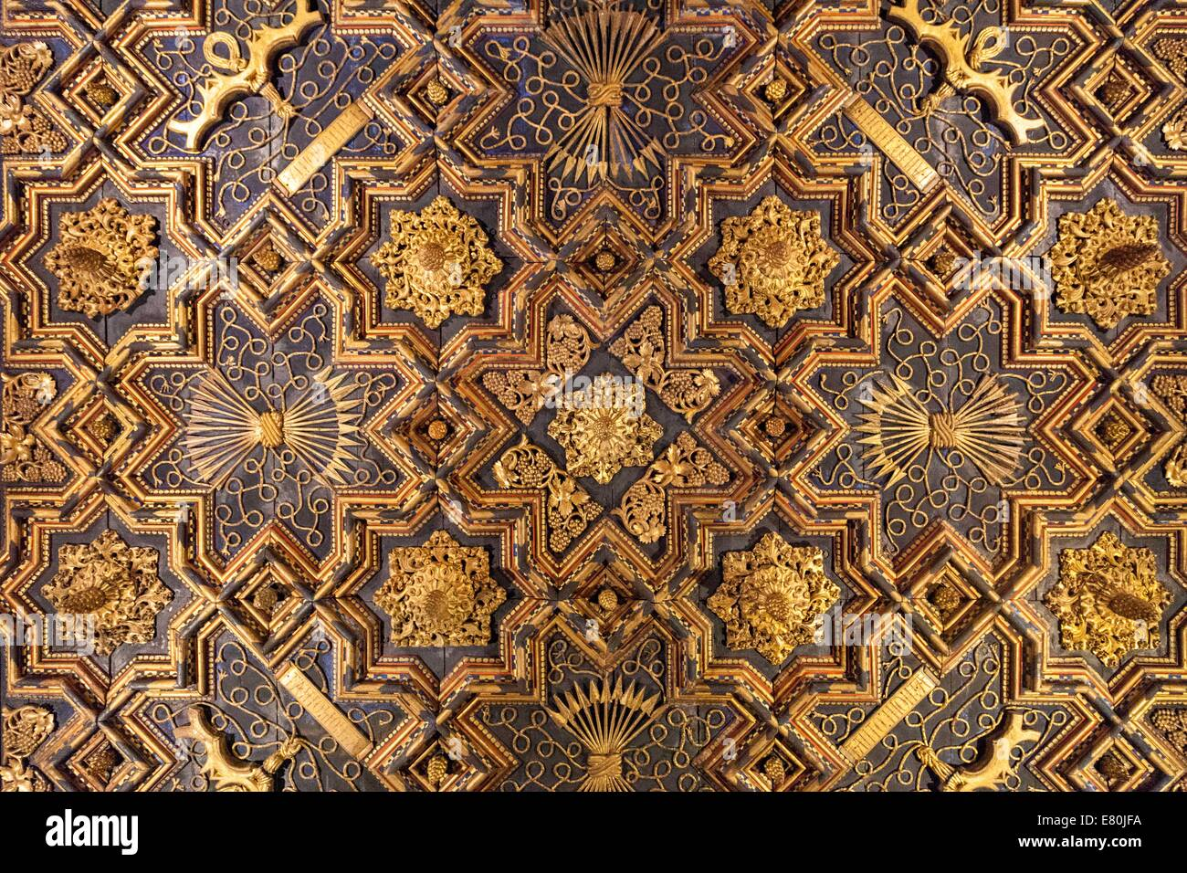 Elaborate decorative geometric pattern in the ceiling tiles of the Aljaferia Palace, Zaragoza Spain - Stock Image