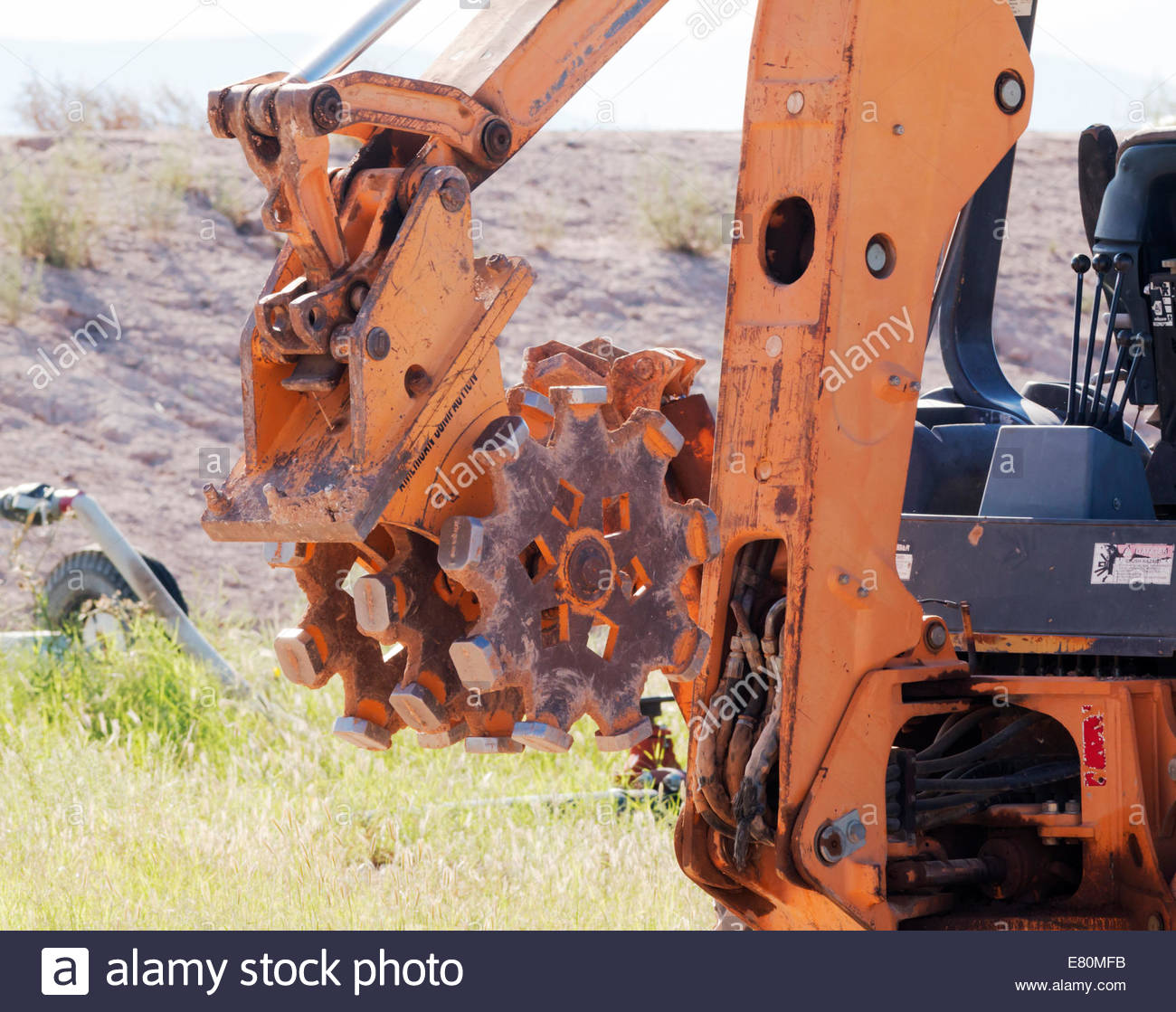 Pad Foot Roller Compactor attachment on backhoe Arizona - Stock Image