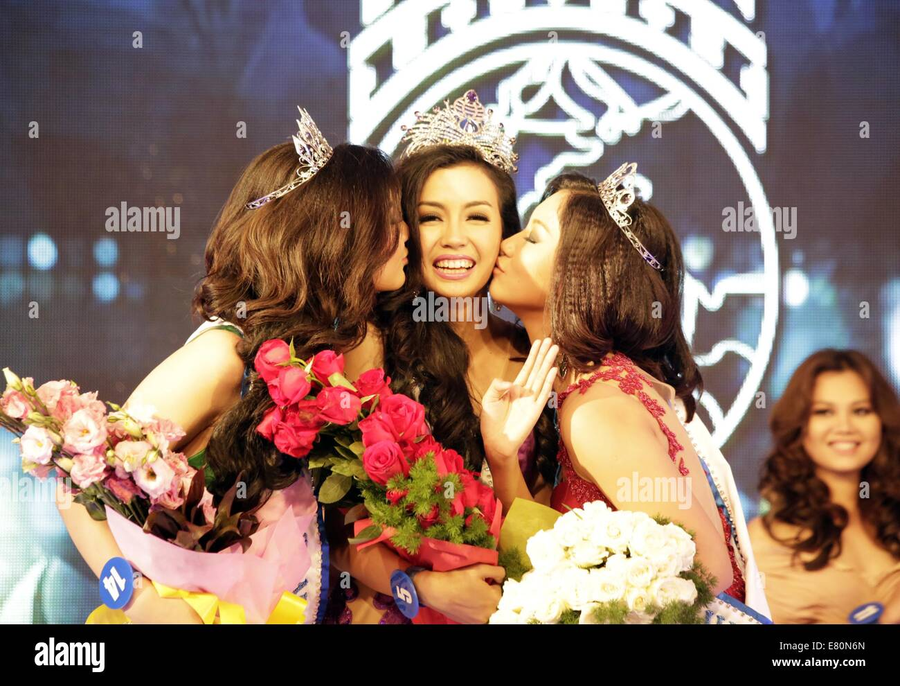 Yangon. 27th Sep, 2014. Miss Myanmar World Wyne Lay (C) receives kisses after winning the crown at the Miss Myanmar Stock Photo