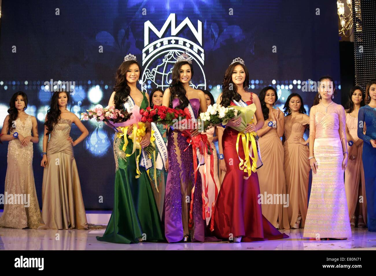 Yangon. 27th Sep, 2014. Miss Myanmar World Wyne Lay (C Front) poses for photos after winning the crown at the Miss Stock Photo
