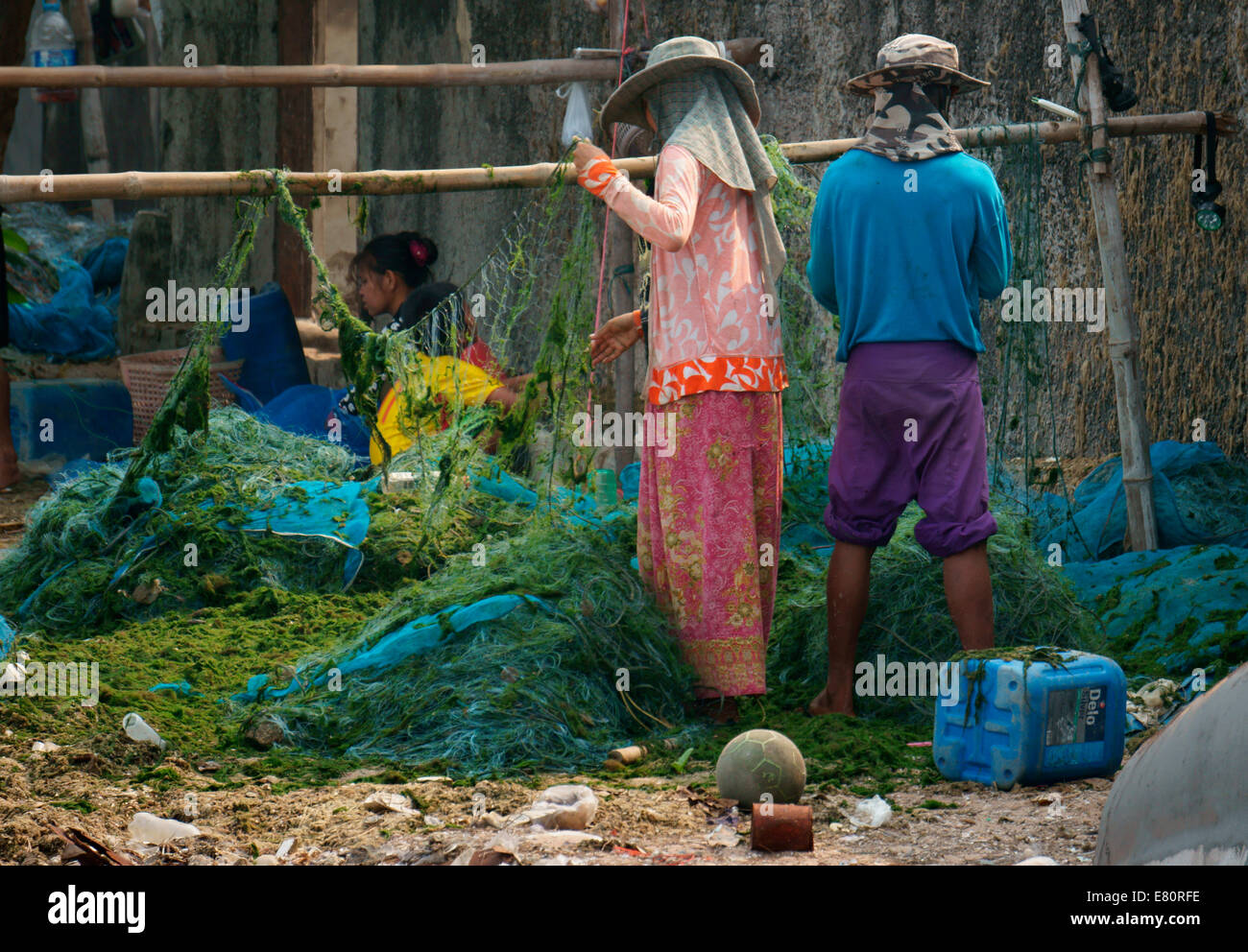 Fishermen's family is tending to nets,up keep,getting ready for next ketch - Stock Image