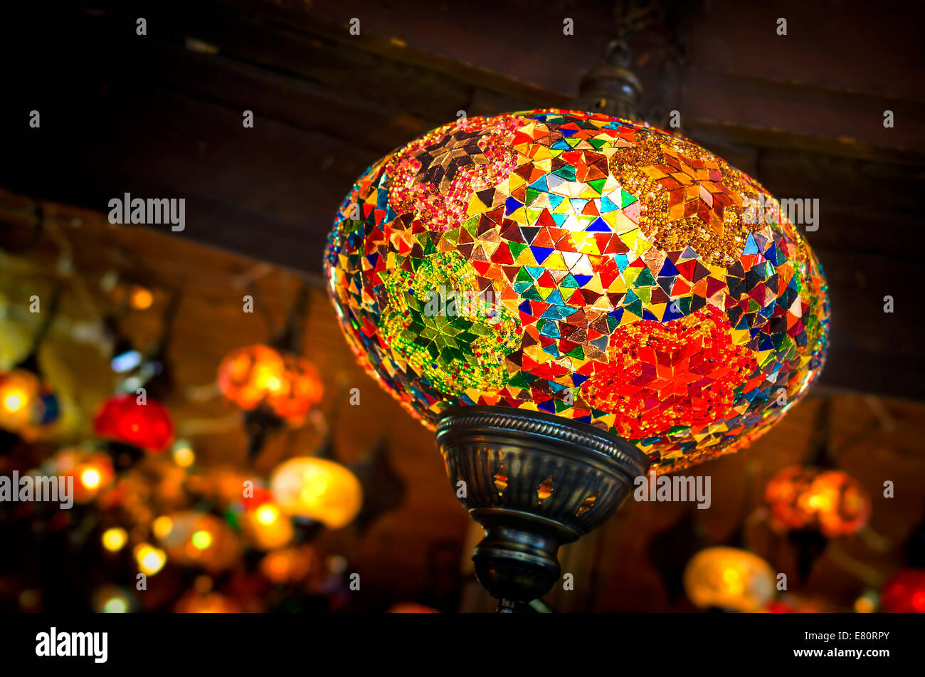 Old oriental lamp shines rays of soft light - Stock Image