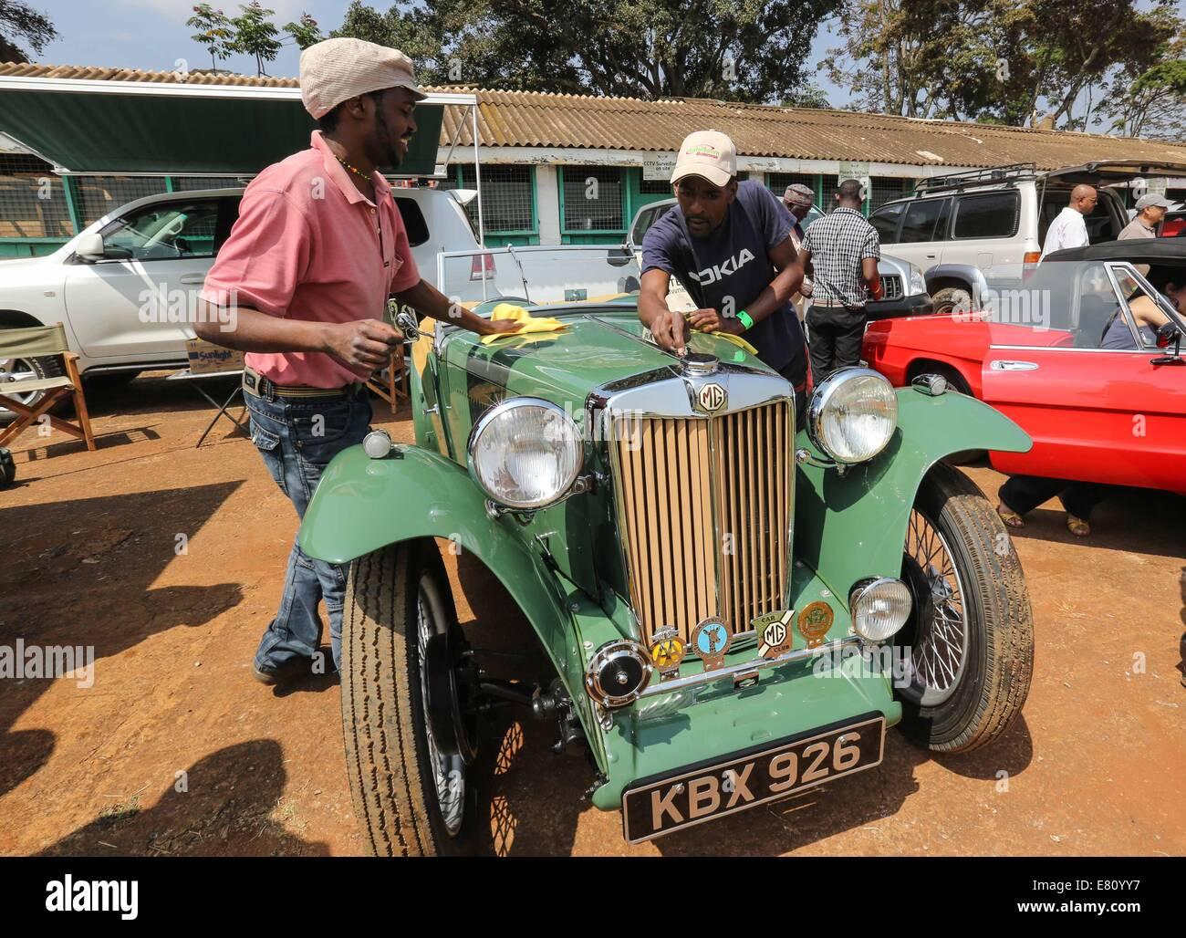 Nairobi, Kenya. 28th Sep, 2014. Staff workers wipe a vintage car ...