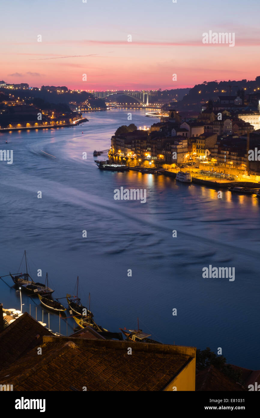 Early evening sunset, looking west over the Douro river, Oporto, Portugal - Stock Image
