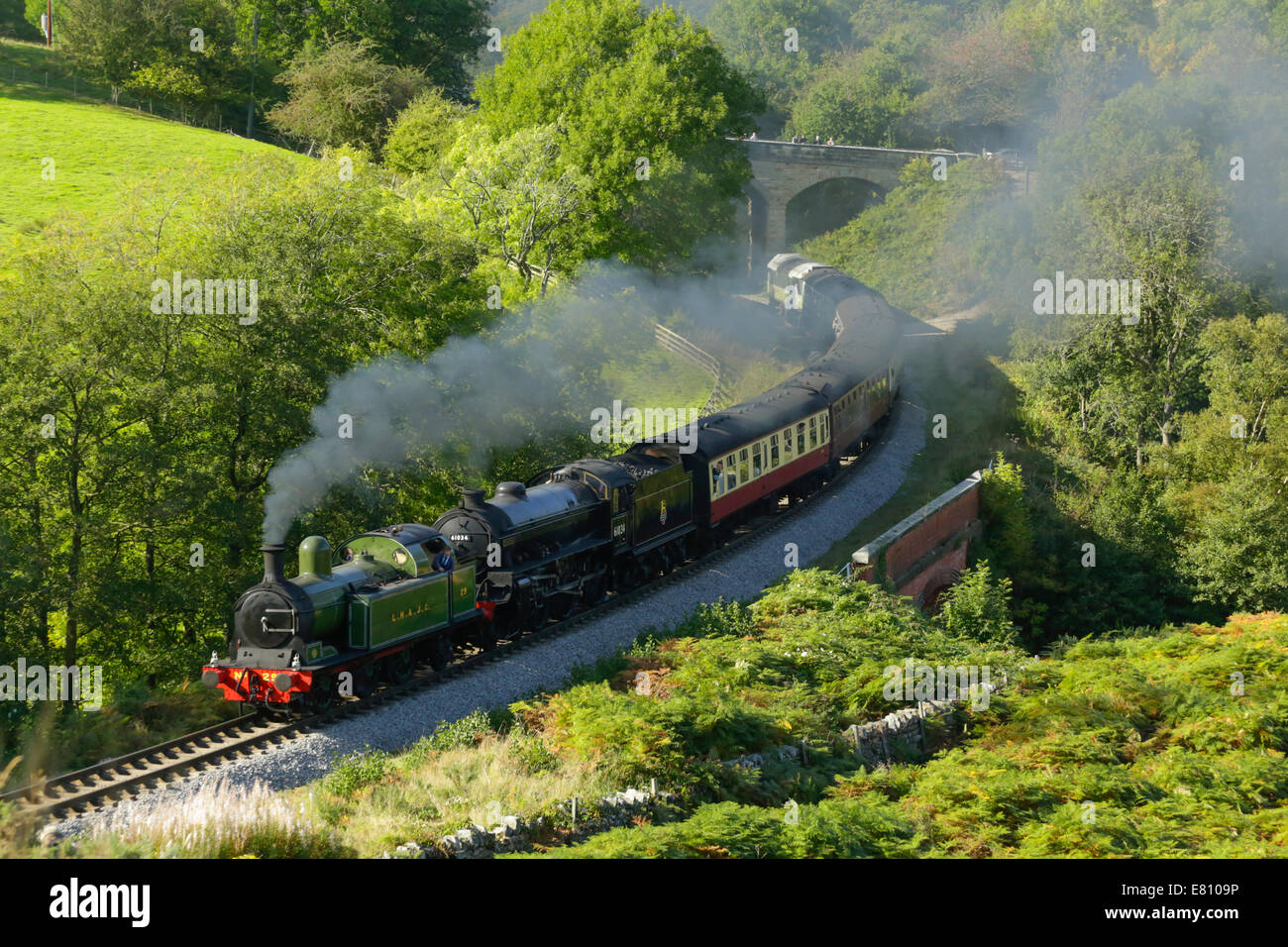 Two steam locomotives at Darnholme near Goathland on the North Yorkshire Moors steam heritage rail line. - Stock Image