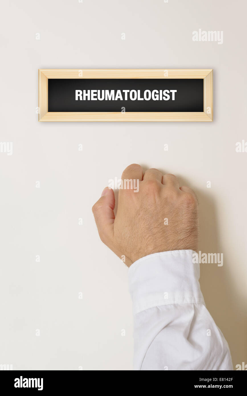 Male patient knocking on Rheumatologist door for a medical exam. - Stock Image