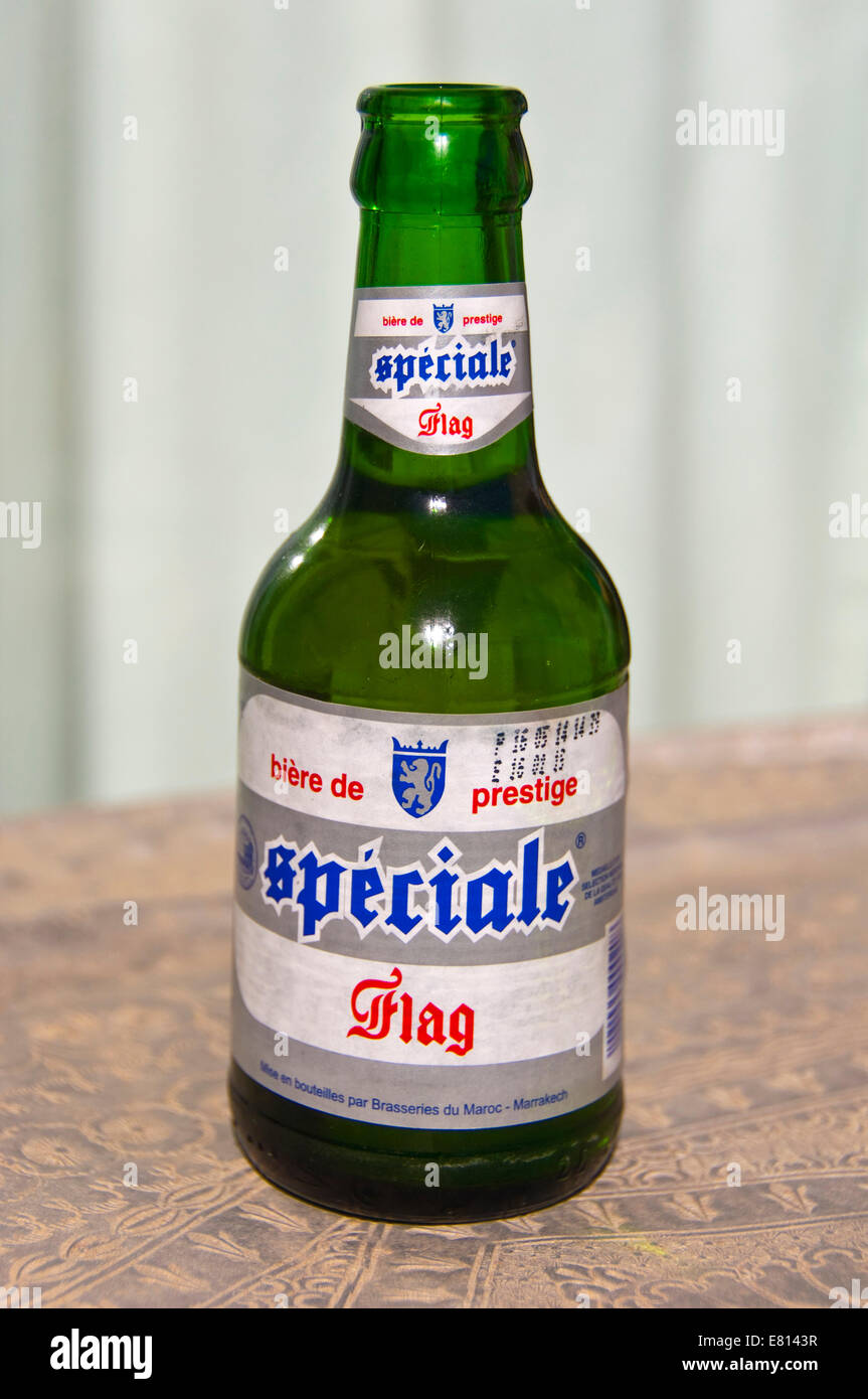 vertical-close-up-of-an-open-bottle-of-spciale-flag-moroccan-beer-E8143R.jpg