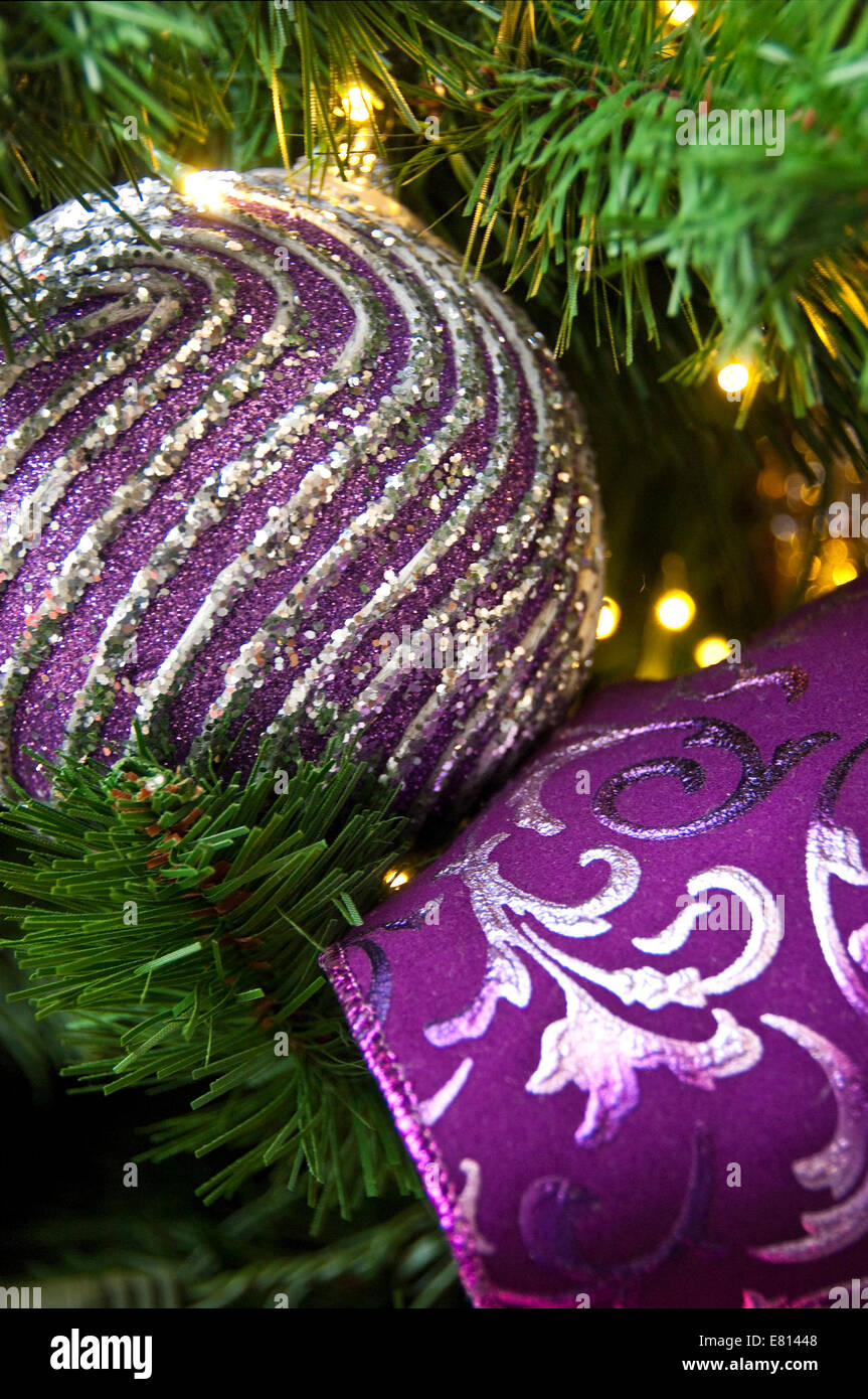 Vertical close up of brightly coloured ornamental Christmas ...