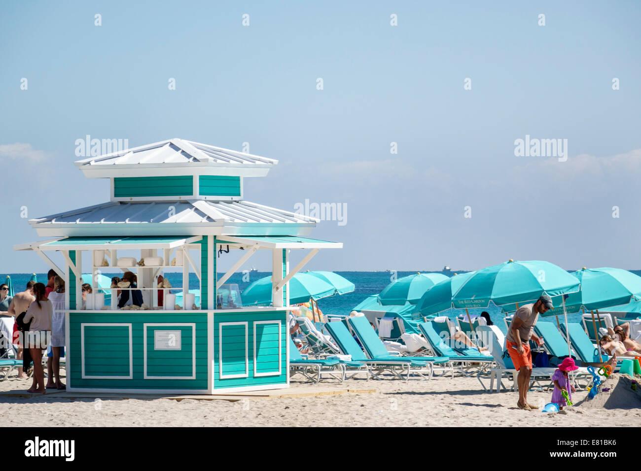 Miami Beach Florida kiosk rental umbrellas lounge chairs Atlantic Ocean Stock Photo