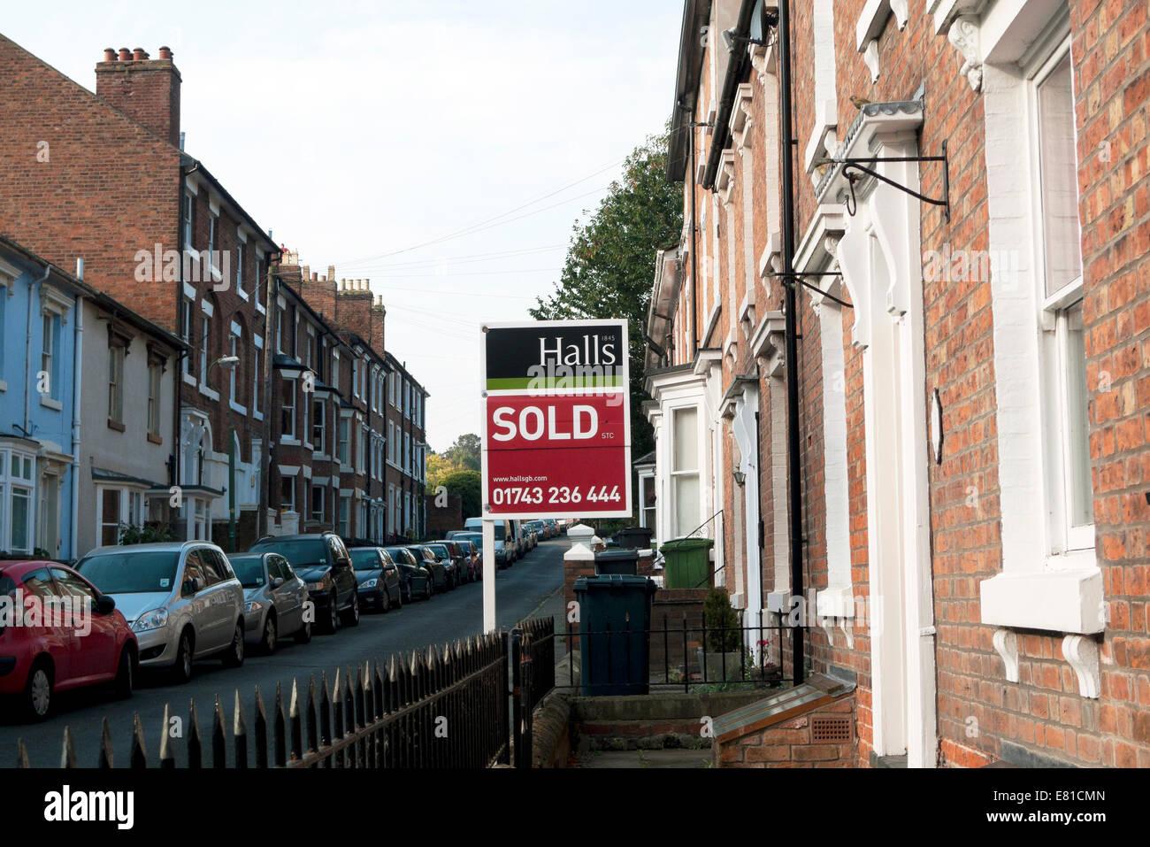 Hall's Estate Agent Sold Sign in Victoria Street Shrewsbury England, UK  KATHY DEWITT - Stock Image