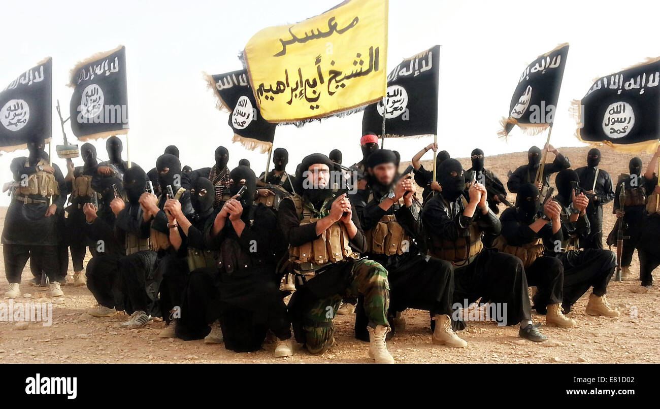 Islamic State of Iraq and the Levant fighters pose in a propaganda photo released by the organization. - Stock Image