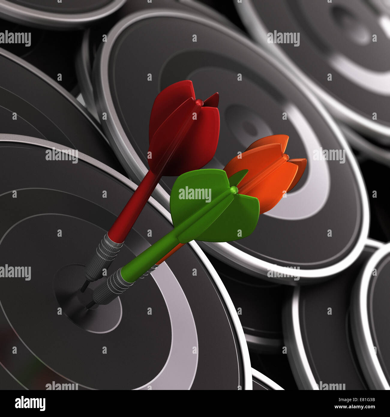 Three darts in the center of a black target, with many other ones around it. Concept image to illustrate business - Stock Image