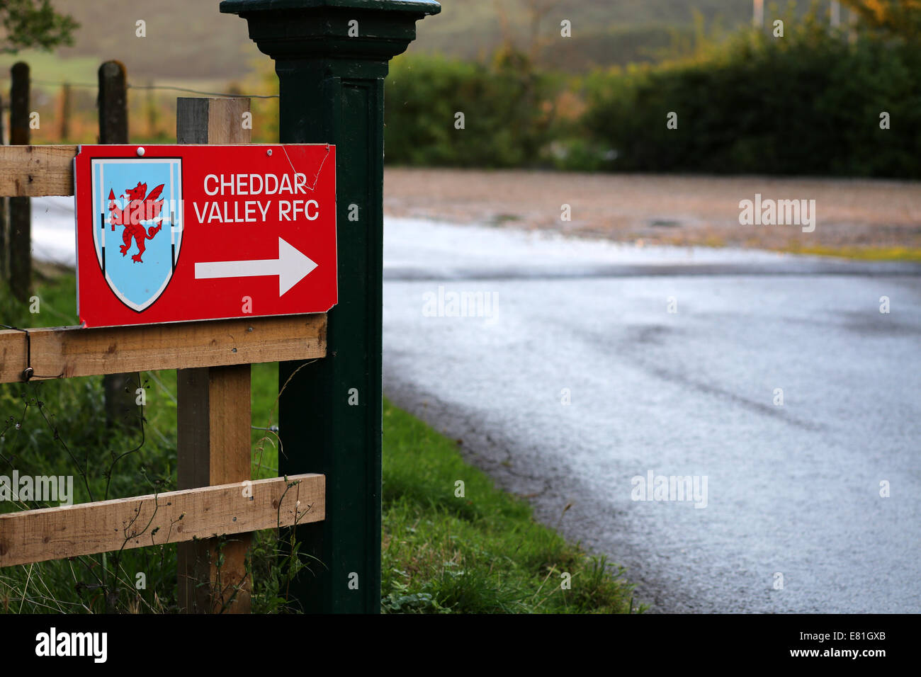 Direction sign with arrow into the Cheddar Valley Rugby RFC Club car park, 14th August 2014 - Stock Image