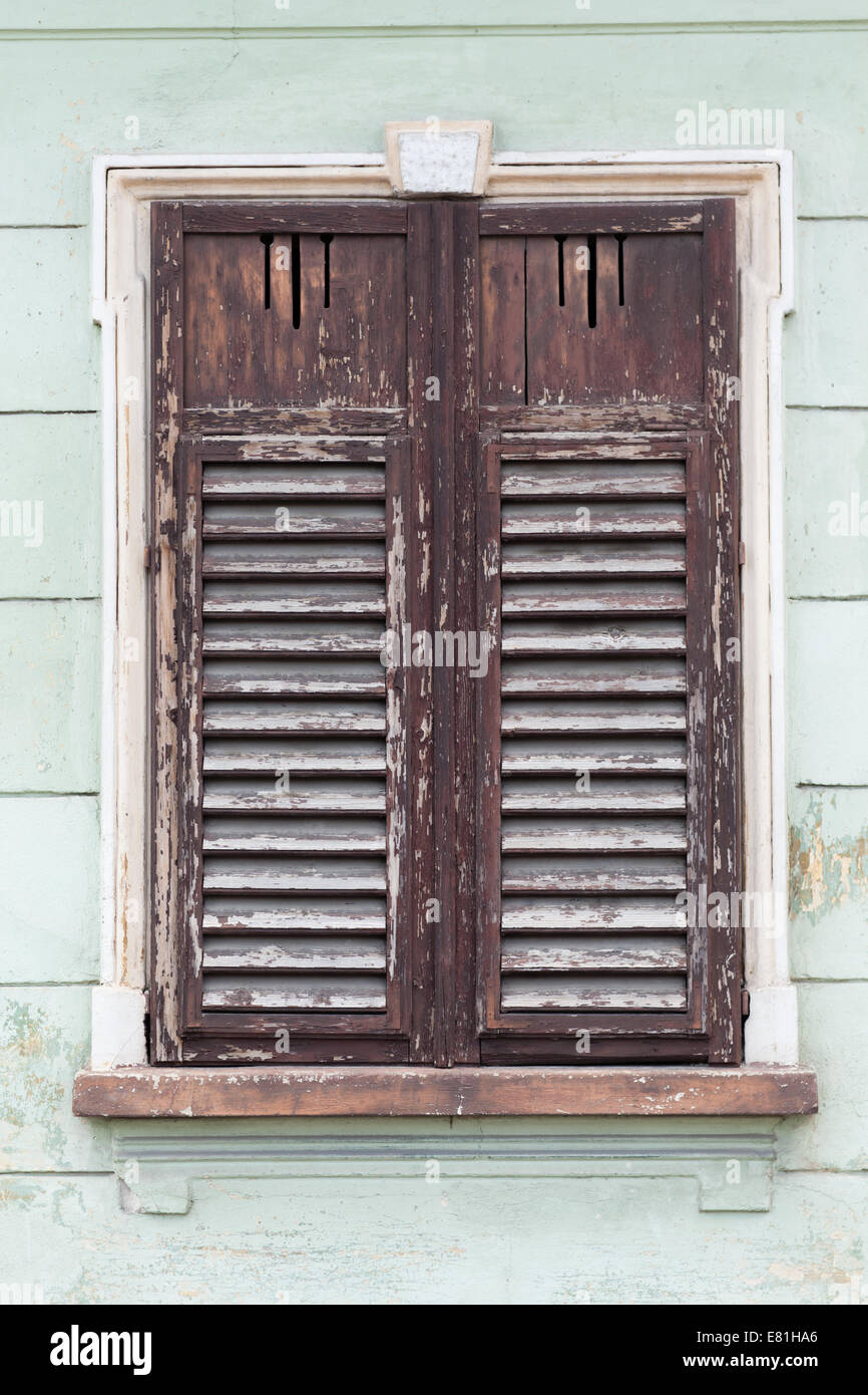 rustic old window closed with wooden exterior shutters Stock Photo ...