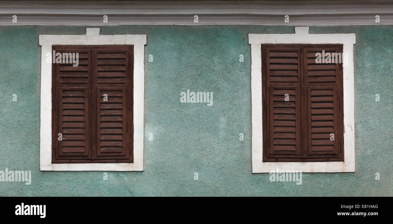 rustic window closed with wooden exterior shutters Stock Photo ...