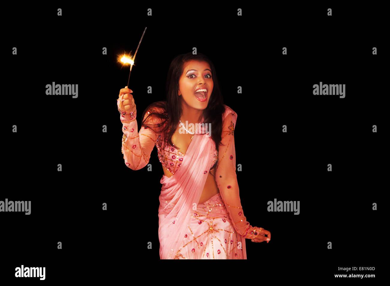 indian Ladies diwali Festival Fire Cracker Stock Photo