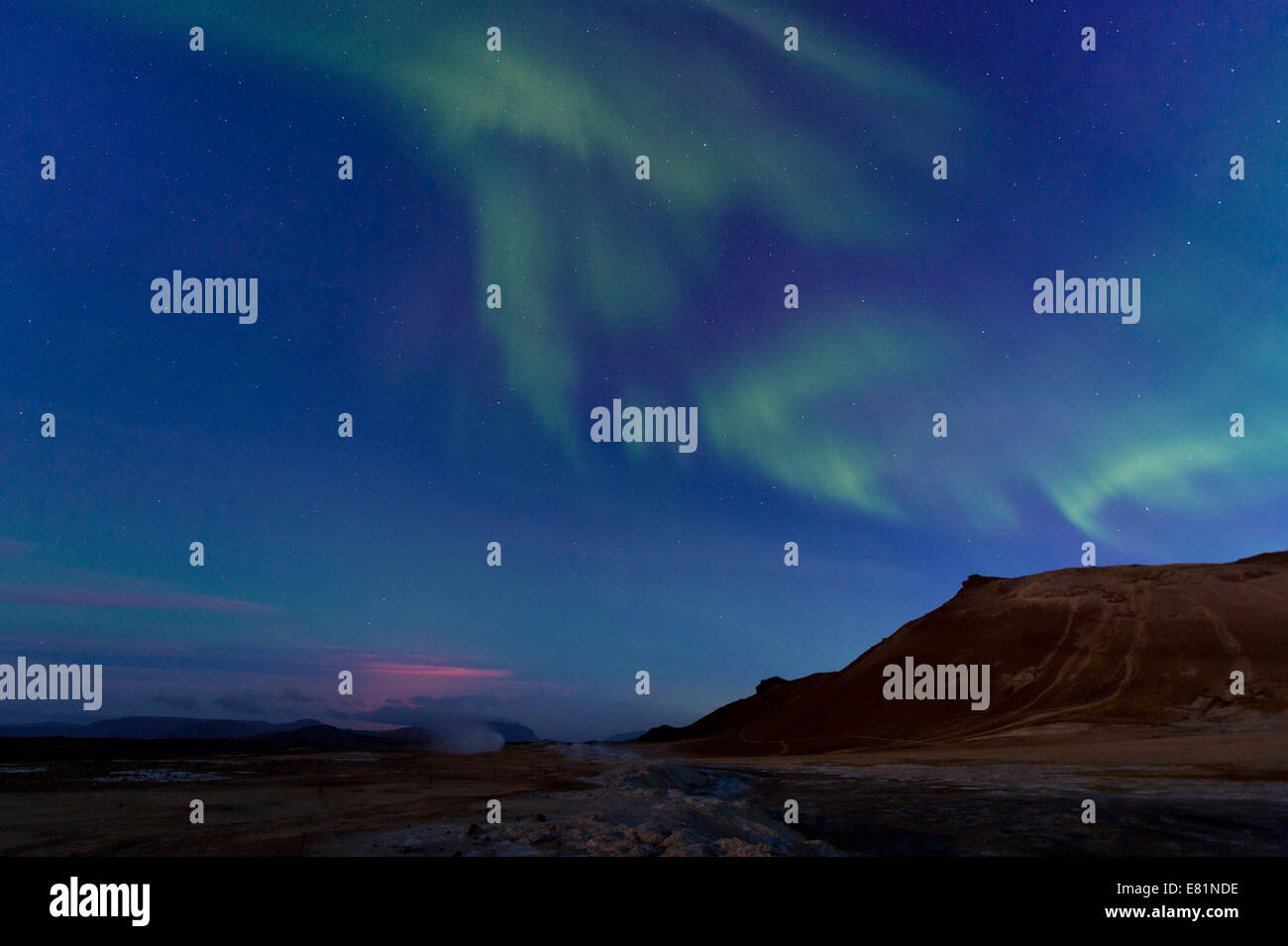 Northern lights, glow from a fissure eruption at the Holuhraun lava field, solfatara, fumaroles, sulphur and other - Stock Image