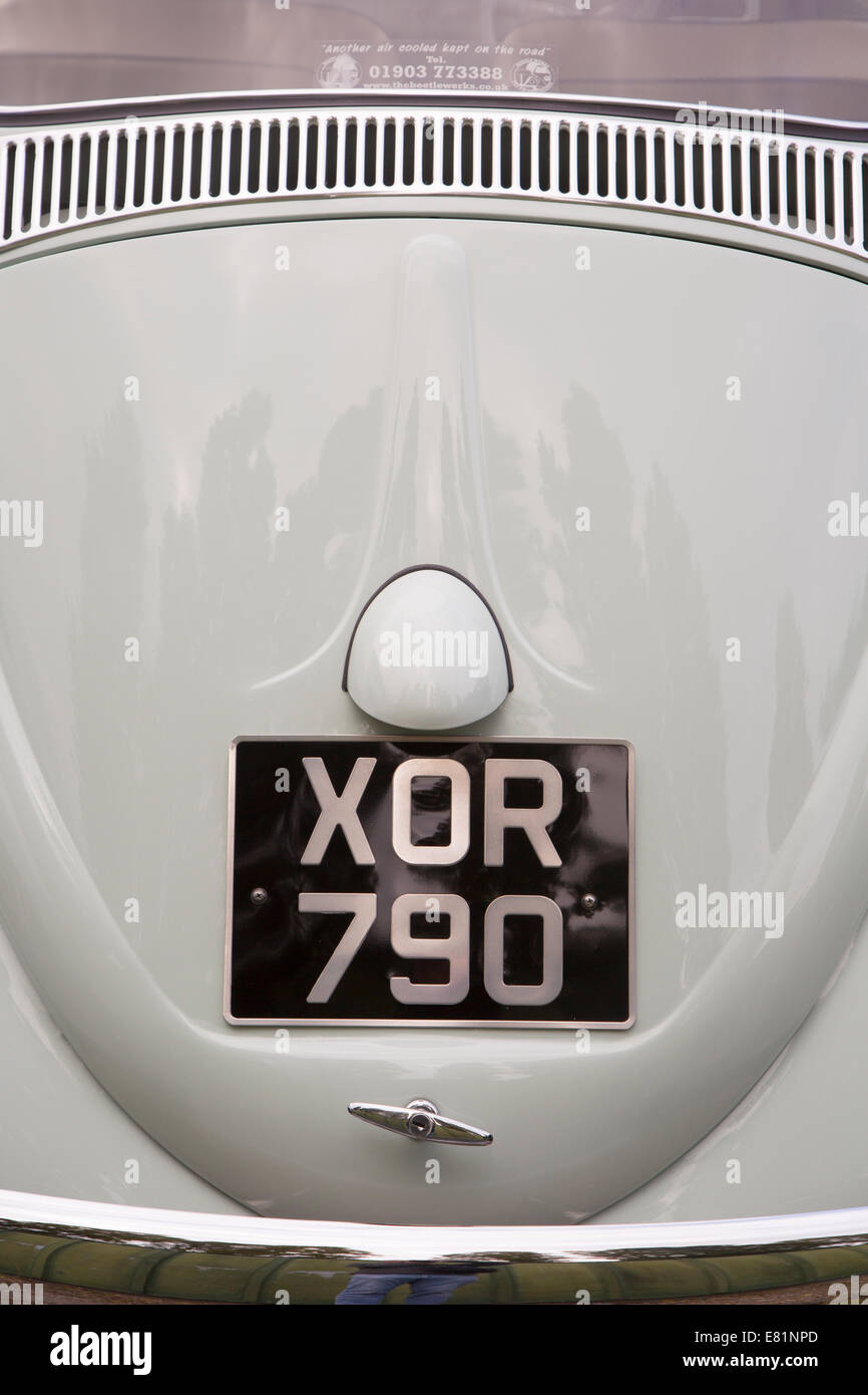 Engine cover and number plate on a classic VW Beetle - Stock Image