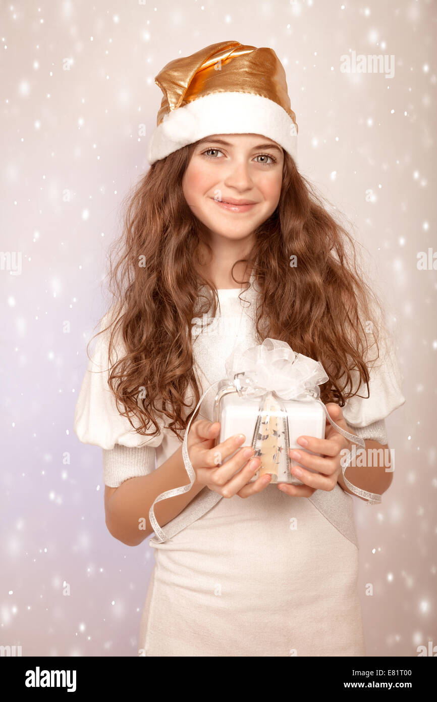 Cute Christmas Gifts For Teenage Girls.Portrait Of Cute Teen Girl With Christmas Gift On Snowy