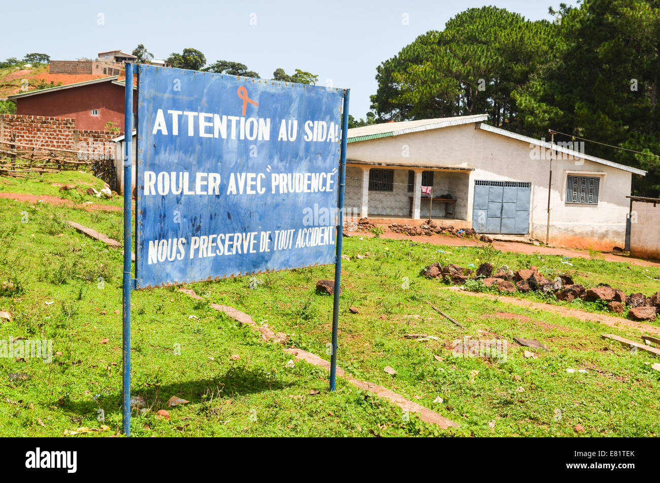 A road sign in Guinea reading in French: 'Be careful with AIDS - Driving safely preserves us from all accidents' - Stock Image