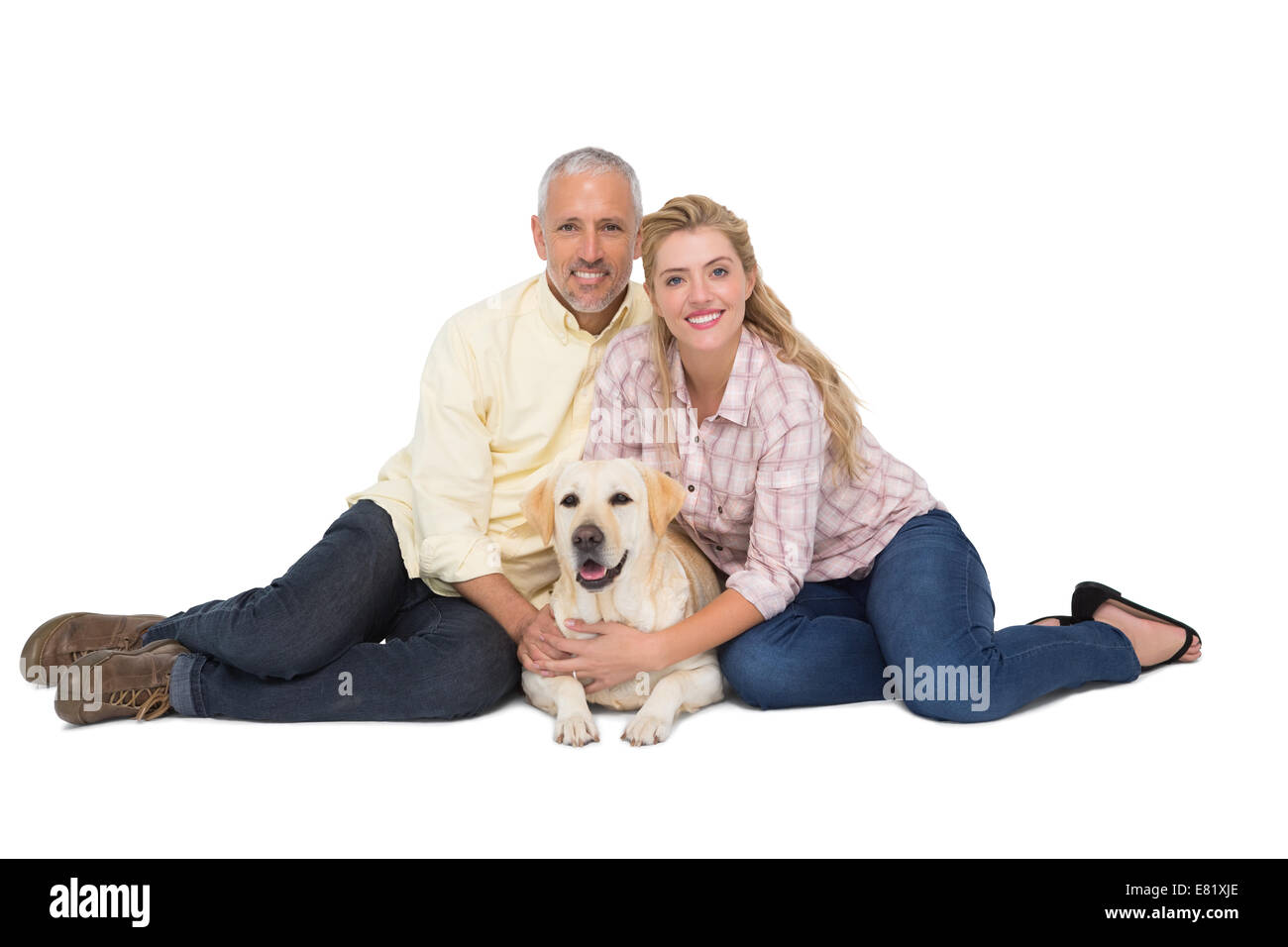 Happy couple with their pet dog - Stock Image