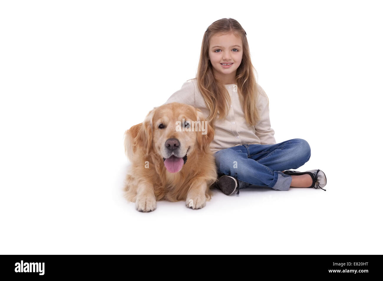 Girl sitting beside her pet dog - Stock Image