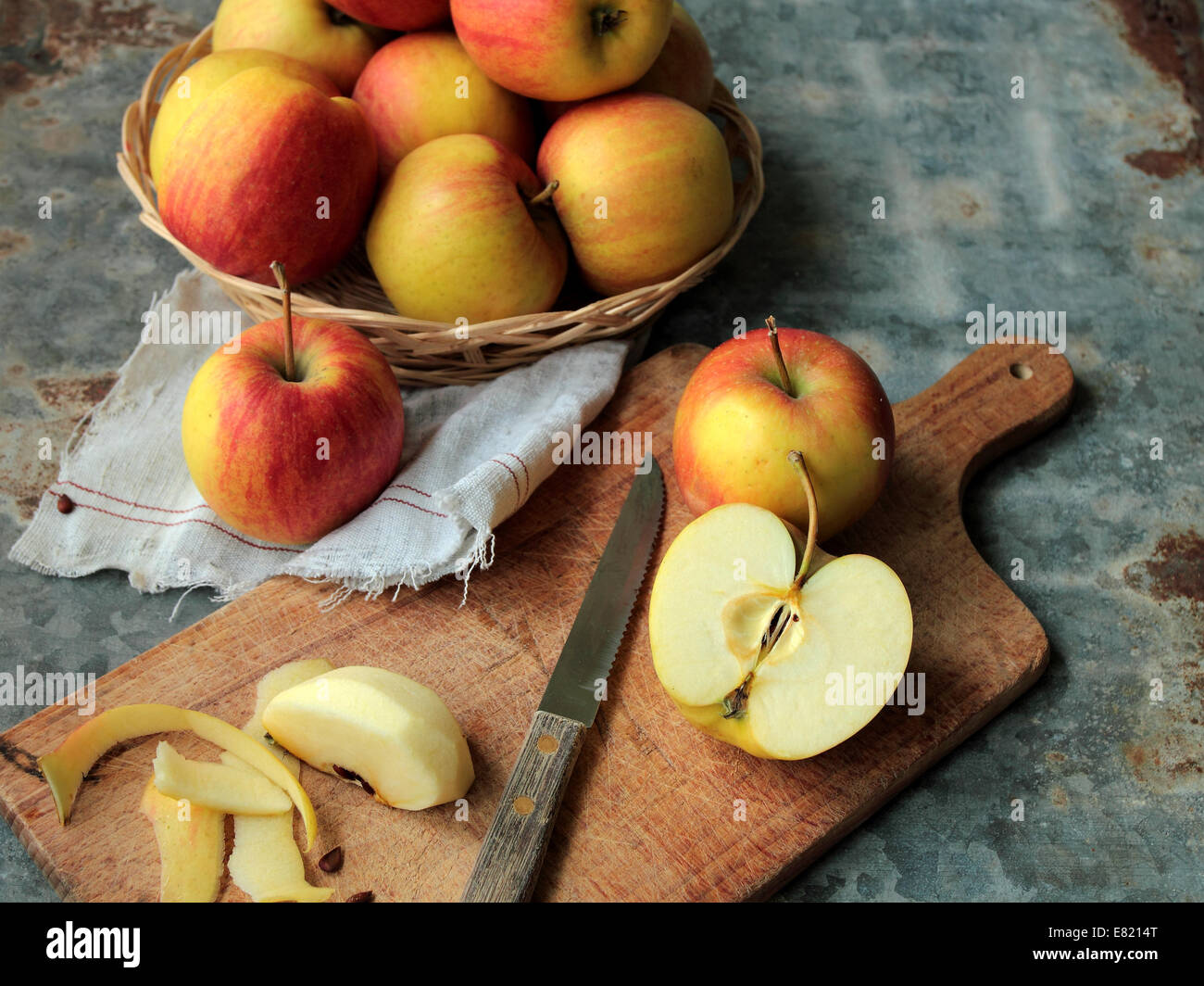 Red apples on cutting board in the kitchen - Stock Image