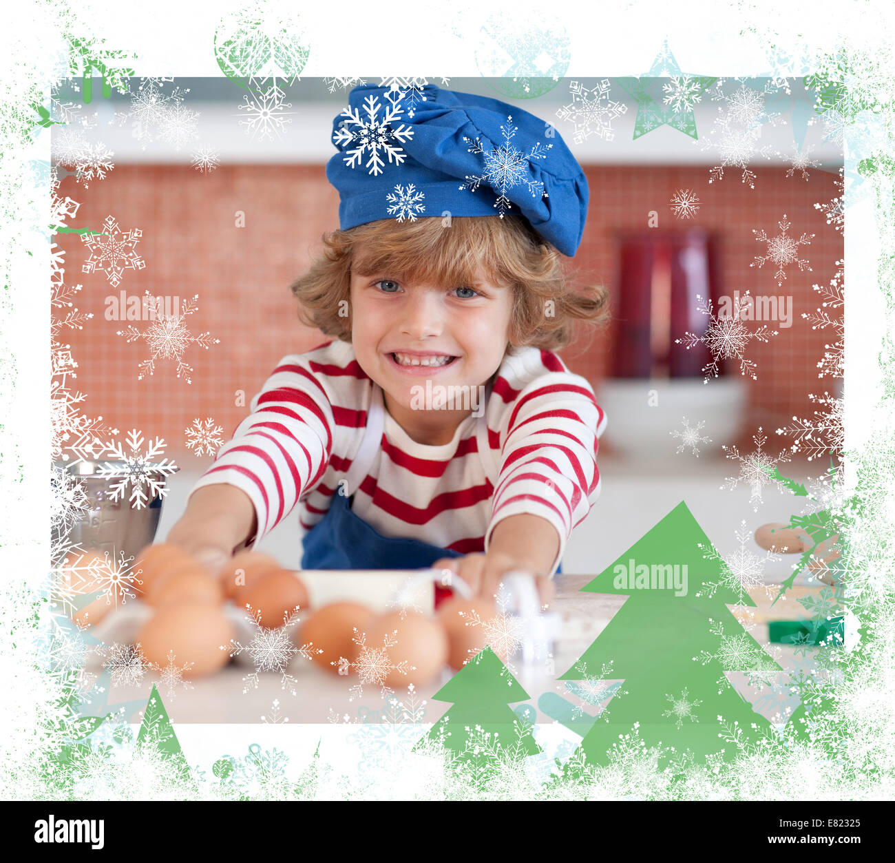 Nice boy baking at home - Stock Image