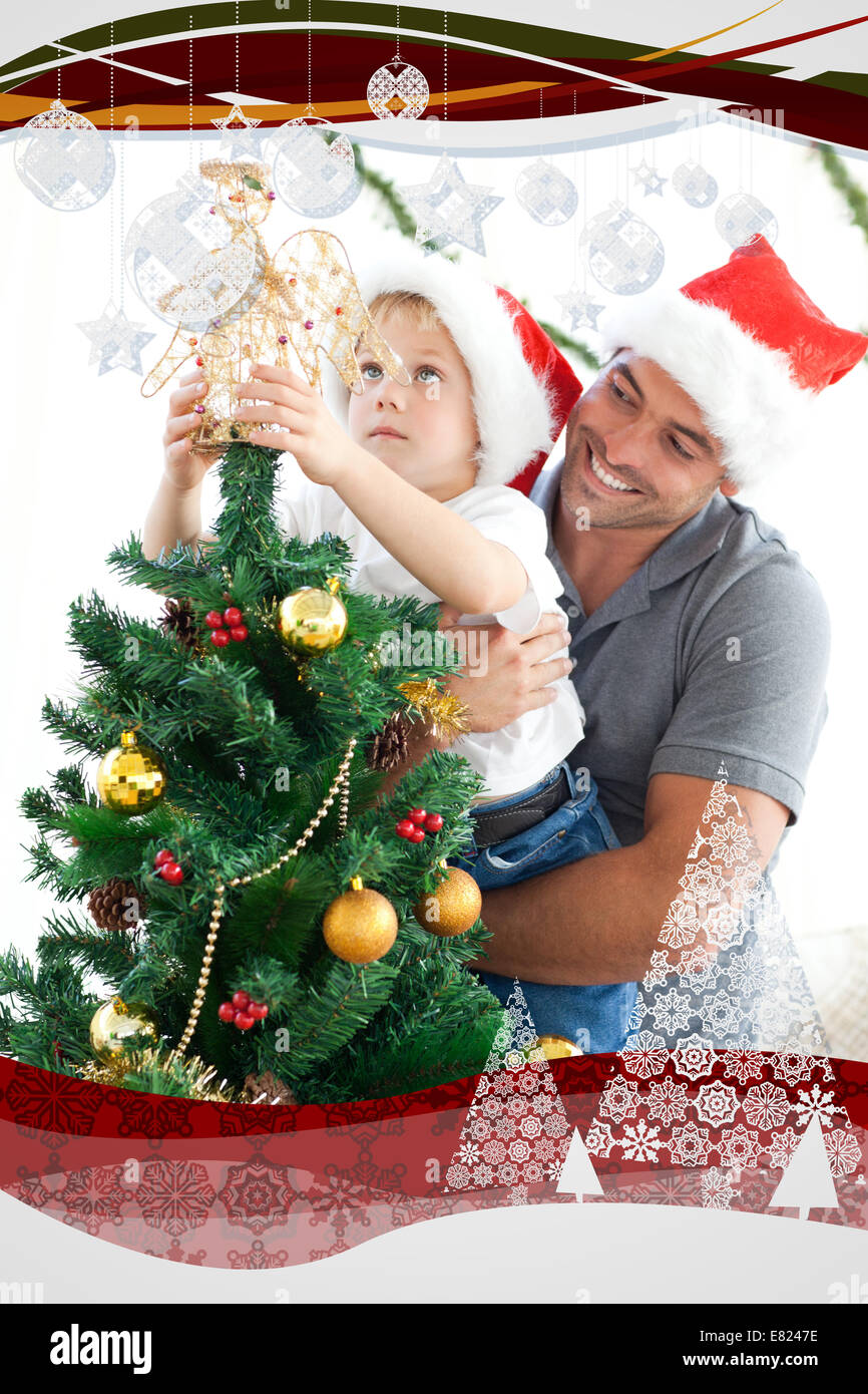 Father and son decorating their christmas tree - Stock Image