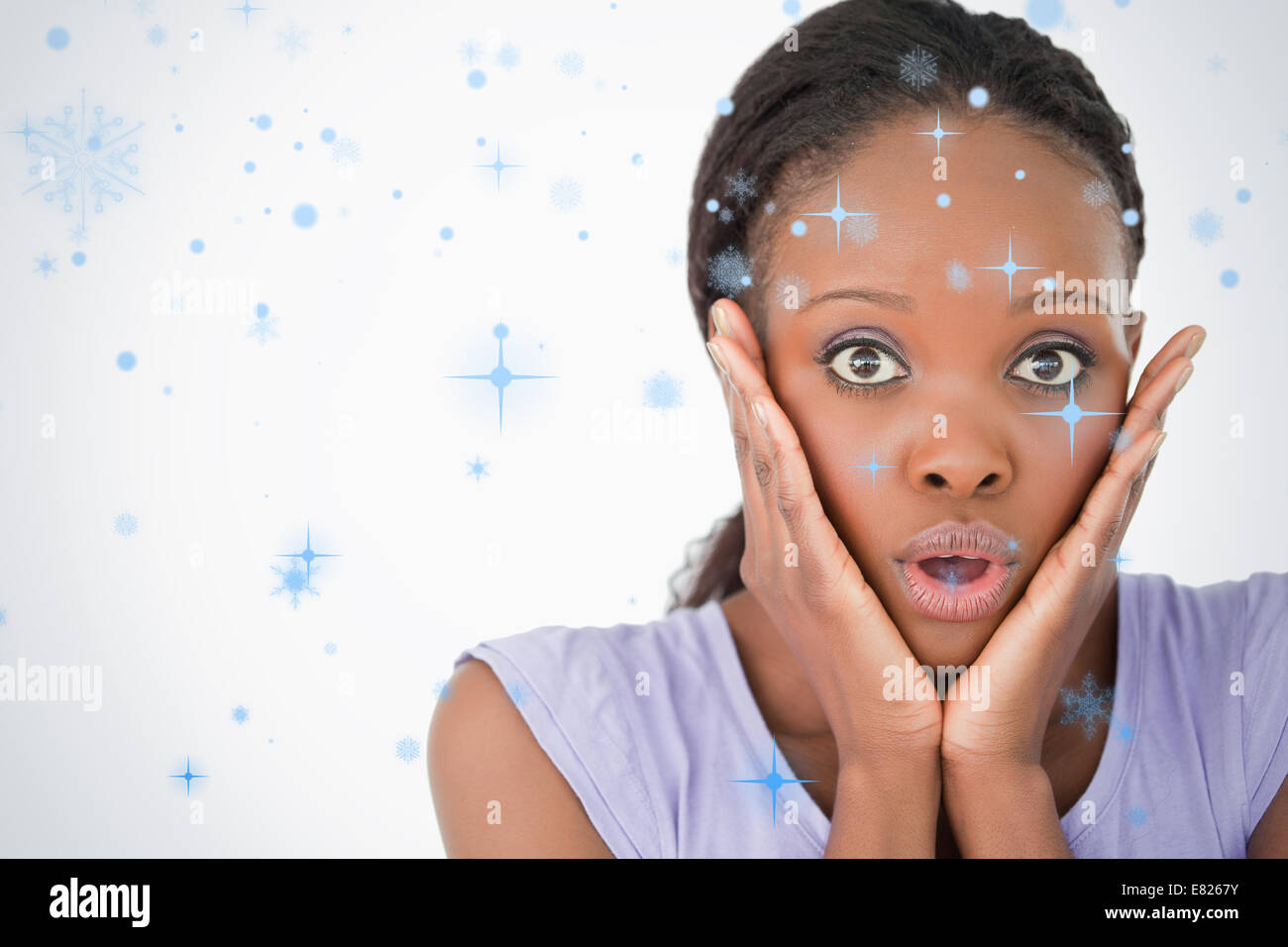 Close up of frightened woman on white background - Stock Image