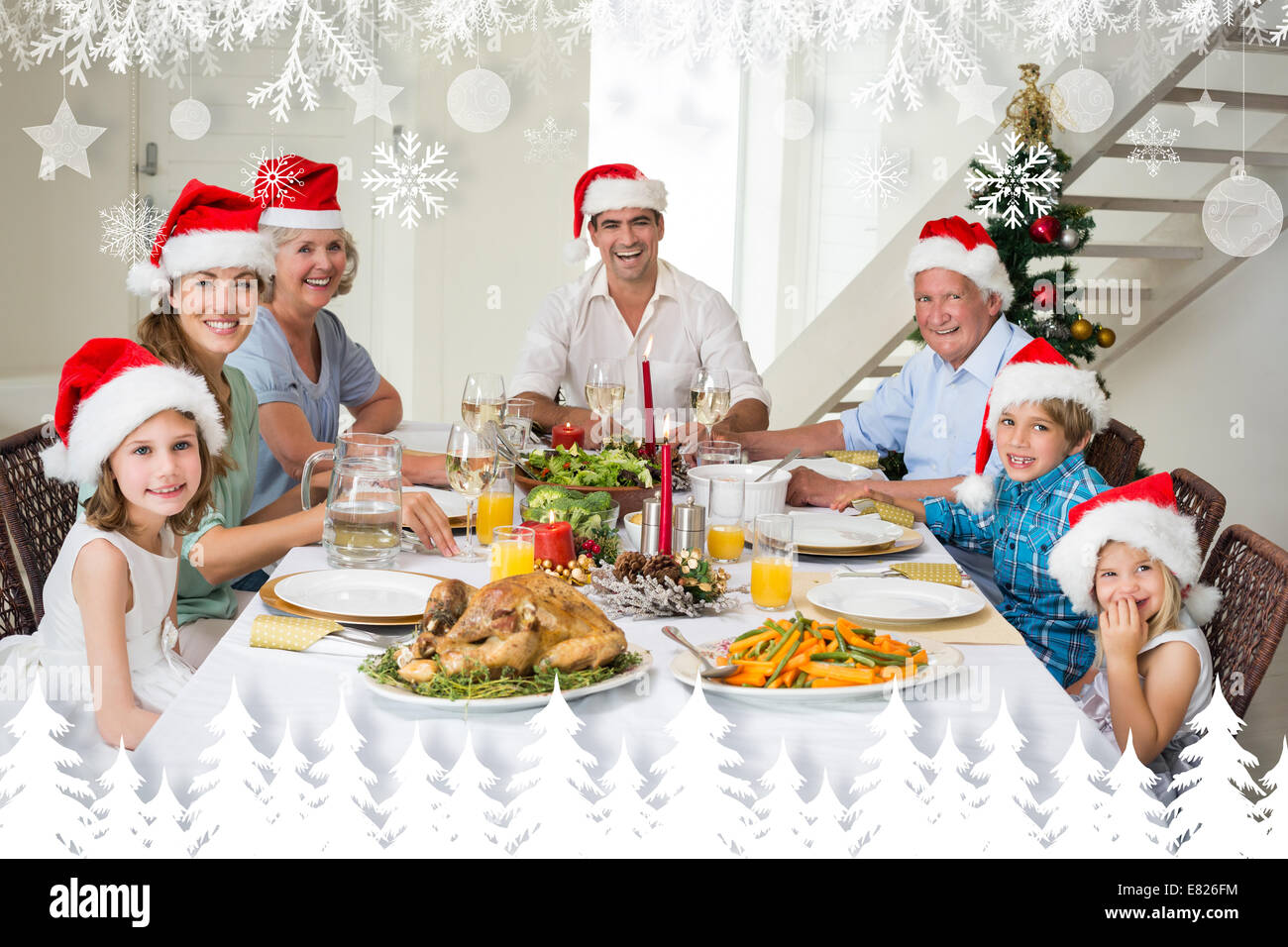 f11e9b150c591 Composite image of happy family in santa hats having christmas meal ...