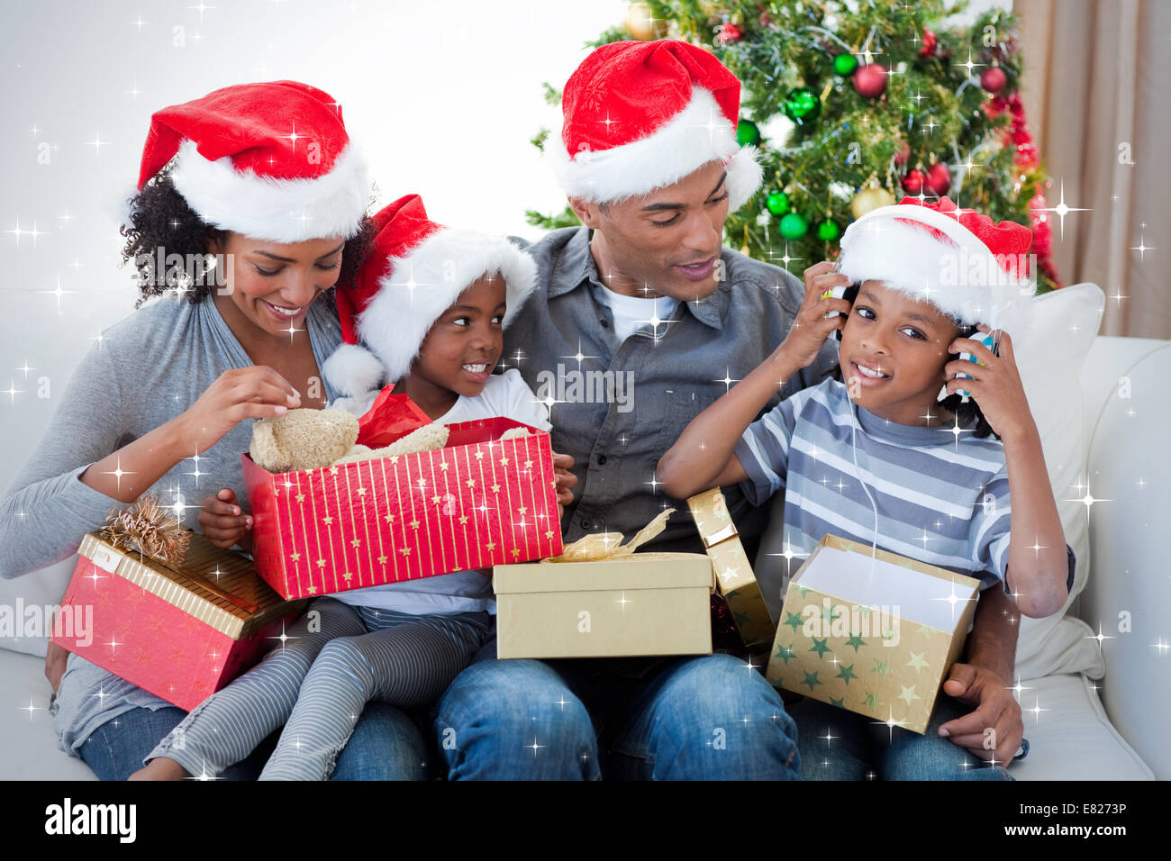 happy family playing with christmas presents stock image - Black Family Christmas Pictures