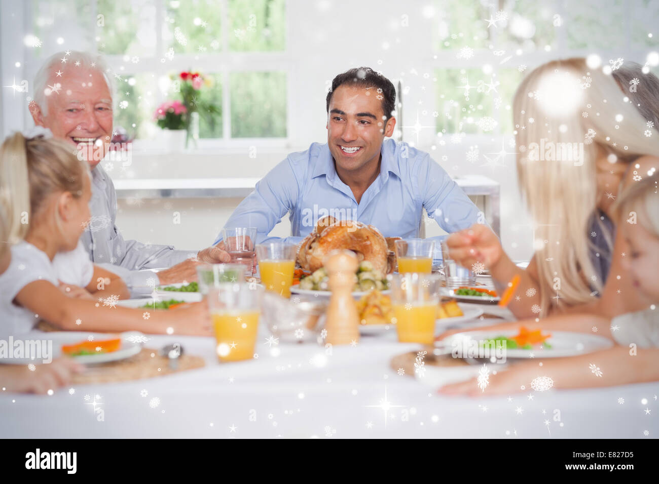 Composite image of happy family at thanksgiving - Stock Image