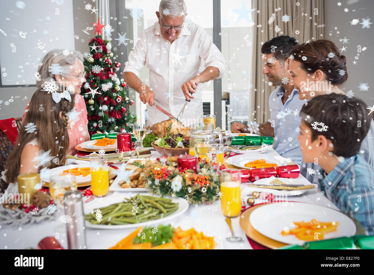 Extended family at dining table for christmas dinner - Stock Image